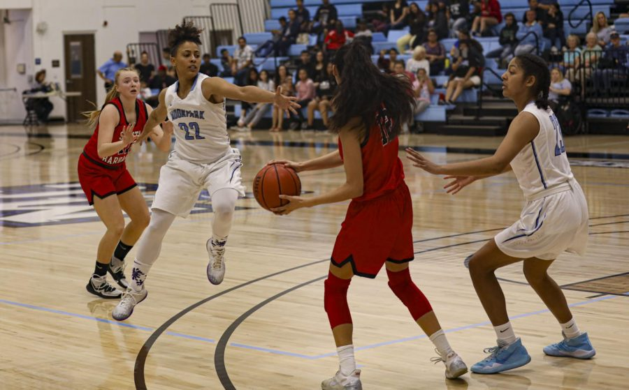 Sophomore guard Breanna Calhoun hops up to block a pass from Santa Barbara's Sophia Torres during the home game against Santa Barbara City College on Saturday, Feb. 1. Photo credit: Ryan Bough