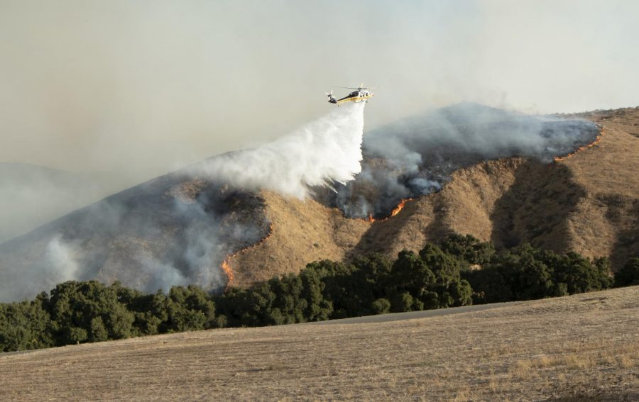 Emergency aerial vehicles drop loads of water on the scorching Easy Fire on Wednesday, Oct. 30, 2019, in Simi Valley, Calif. Photo credit: Evan Reinhardt