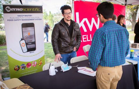 Michael Black (left), 22, talks Mohit Sukhija, 18, a quality manager from SensoScientific, at the Career and Intership Expo on campus at Moorpark College on Wednesday, March 14, 2018. Many companies like SensoScientific are searching for innovative minds at Moorpark College. Photo credit: Evan Reinhardt