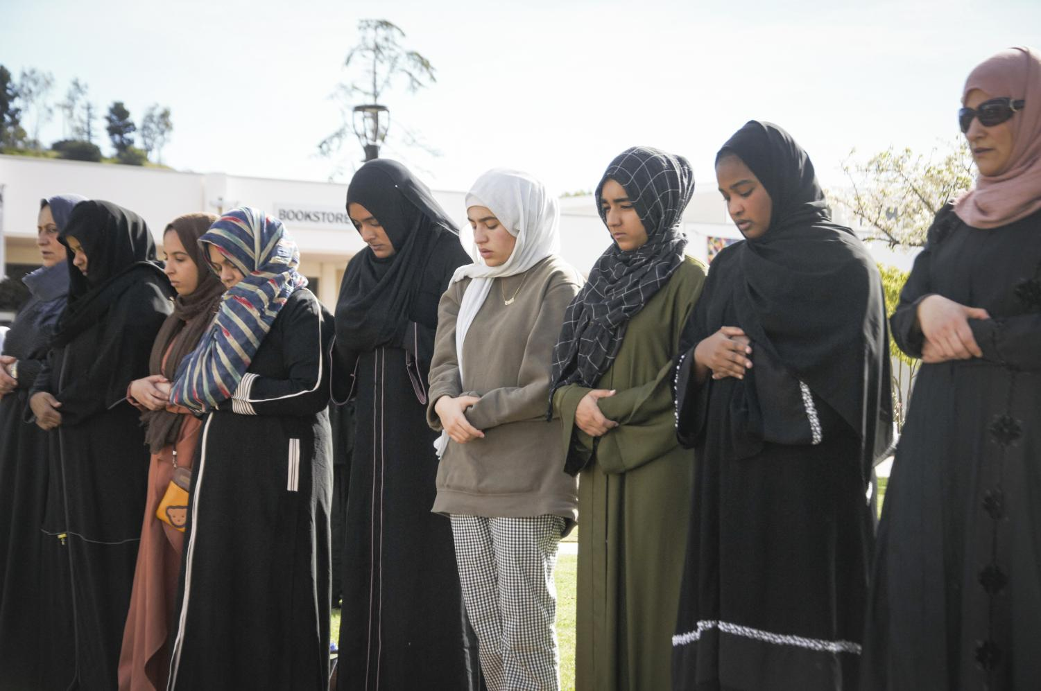 Members of the Moorpark College Muslim Student Association stand for the Jumu'ah prayer on campus on Friday, Jan. 31. The sermon and prayer is the final celebration for Islam Awareness Week. Photo credit: Morgan Ellis