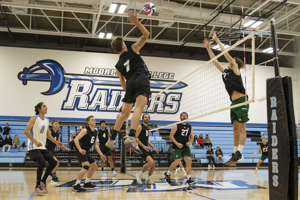Outside Hitter Ryan Horan hits an opposite set from Lucas Ogg during Moorpark's game against Golden West College on Wednesday, Feb. 12. Horan had 11 kills for 31 attack attempts. Photo credit: Evan Reinhardt