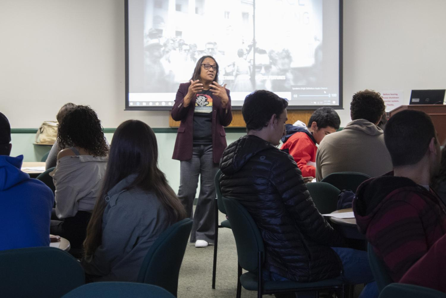 Tamarra Coleman, English Professor and Multi-Cultural Project Specialist, speaks to Students before showing the movie 'I am not your Negro' for Black History Month, on Wednesday, Feb. 5. The movie was shown in the Campus Center Conference Room. Photo credit: Scott Mazzarano