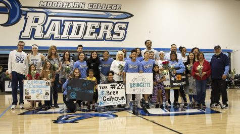Friends and family of the Moorpark women's basketball team join the squad on the court for a photo before the team's game against Oxnard College on sophomore night, Friday, Feb. 21. Moorpark's sophomores include Bree Calhoun, Jazzy Carrasco, Isabel Ayala, Caleigh McClenahan and Britt Van Buren. Photo credit: Evan Reinhardt