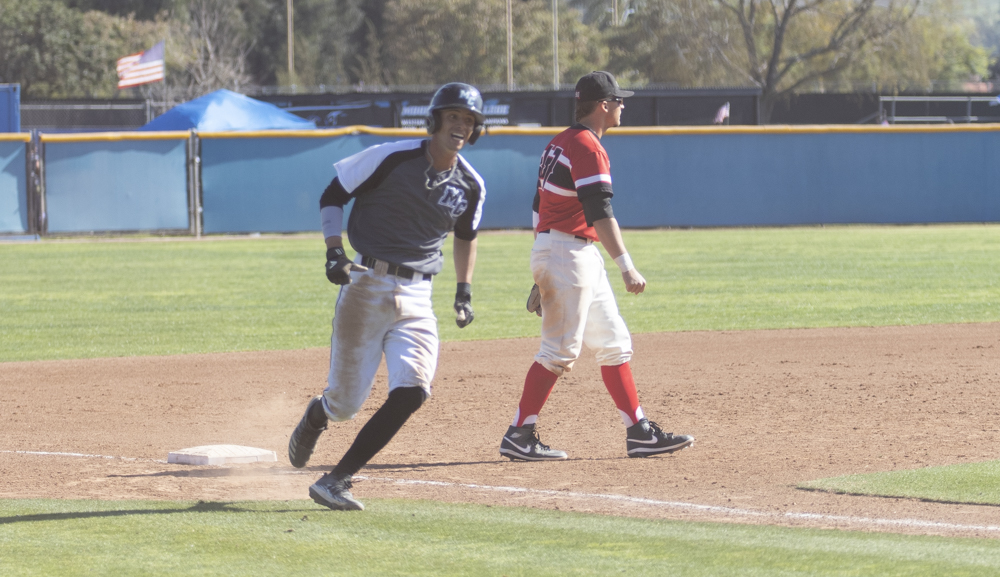 Sophomore Patrick Valdez rounds third on his way home from a Trent Packard RBI on Saturday, Feb. 29, in Moorpark's home game against Pierce College. Packard also allowed sophomore Alex Vega to make it home for a two point play.