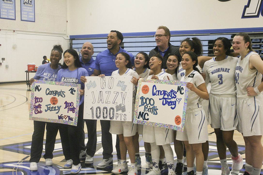 The Raiders got together after the game to hold signs up for Jazzy Carrasco, celebrating her 1000 point milestone, at Moorpark College on Saturday, February 29.
