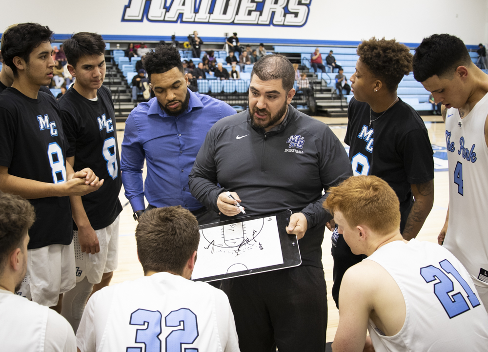 Moorpark College Head Coach Chris Morgan runs a play during a timeout in their home game on Wednesday, Feb. 5 versus Pierce College.