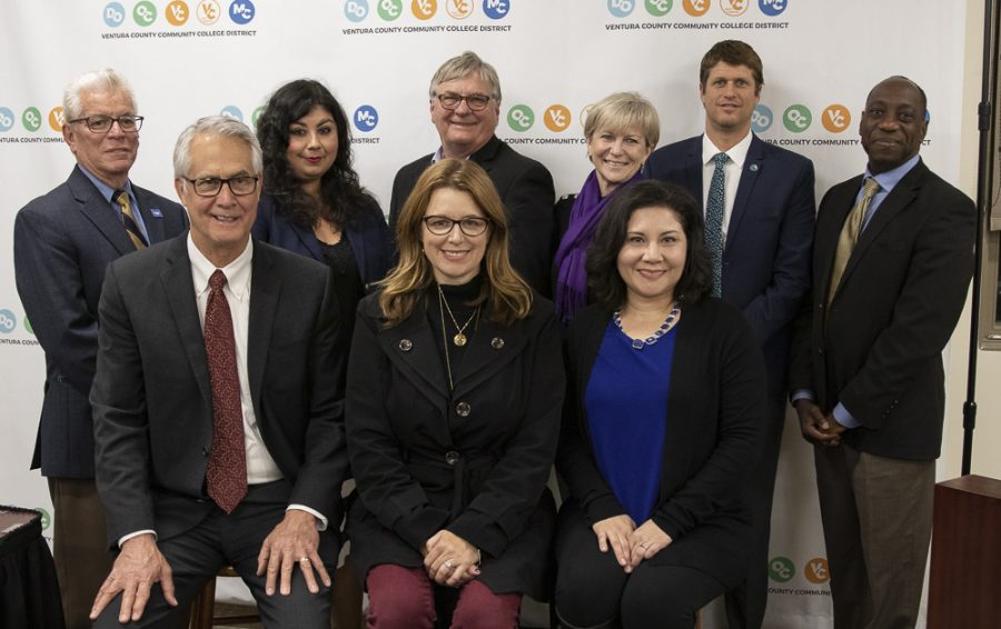 The Ventura County Communty College District Board members pose for a photo with two of the many tenured staff and Interim President Julius Sokenu on Tuesday, March 10, in Camarillo, Calif. Photo credit: Evan Reinhardt