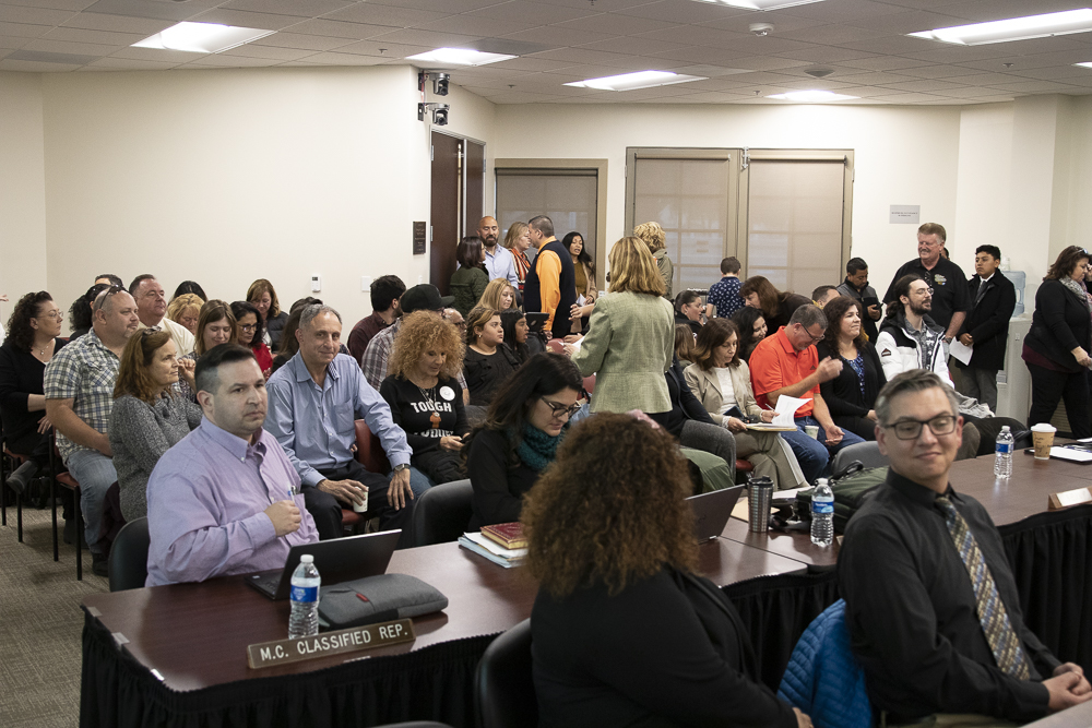 Crowds of tenured staff and their friends and family pack the meeting room prior to the session on Tuesday, March 10, in Camarillo, Calif.