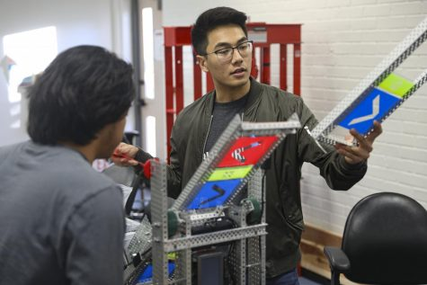 Khoi Le, the lead builder, examines a part of the engineering club's robot 'hai-8s', on Tuesday, Feb. 11, at Moorpark College. The engineering club qualified for the VEX Robotics World Championship in Kentucky. Photo credit: Ryan Bough