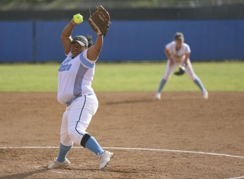 Pitcher Cassandra Akers winds up a pitch during the home game against Cuesta College on Thursday, Mar. 5. Akers pitched a 5.20 ERA. Photo credit: Ryan Bough