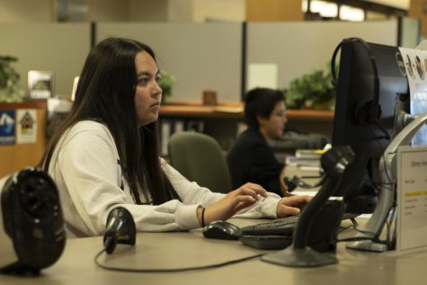 Student worker Carissa Fernandez maintains her position in the Moorpark College library one day after student workers were permitted to not attend work, on Tuesday, March 17. Fernandez is a biology major. Photo credit: Evan Reinhardt