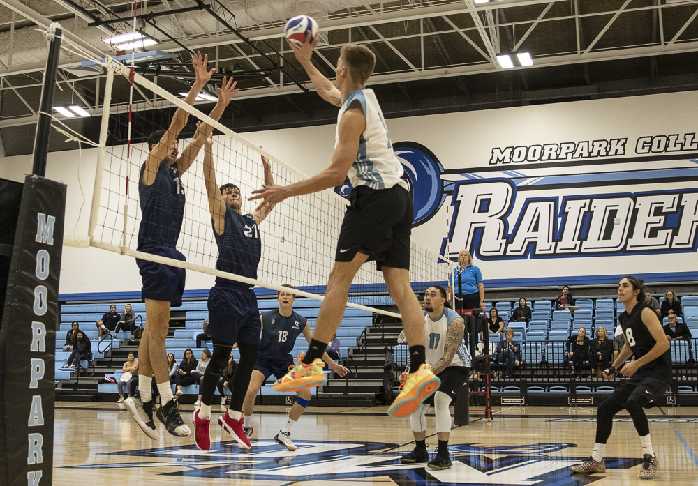 Sophomore Ryan Horan aims a tip over the Warrior block on Wednesday, March 4 at Moorpark College.
