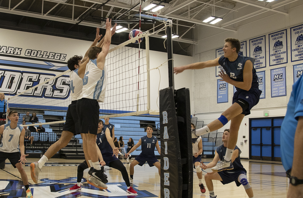 Middle blocker Shawn Krantz and setter Lucas Ogg jump up for the block against the Warrior outside hitter during the Raiders' home game on Wednesday, March 4.