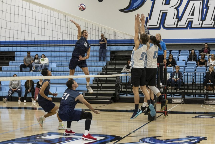 Warriors' outside hitter swings past the Moorpark triple block during the Raiders' home game on Wednesday, March 4. Raiders fell to the Warriors in four sets. Photo credit: Evan Reinhardt