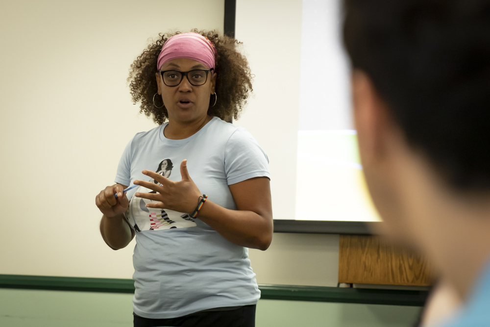 Professor Tamarra Coleman describes her background in advocacy, leading into the theme of the workshop, on Friday, Feb. 28, in the Campus Center conference room.