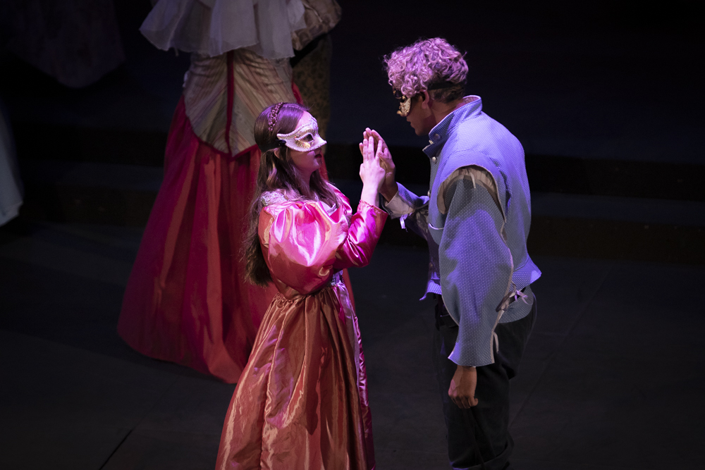 Abby Holland, as Juliet, meets Seth Gunawardena, as Romeo during the first act of Romeo and Juliet performed at Moorpark College on Thursday, March 12.