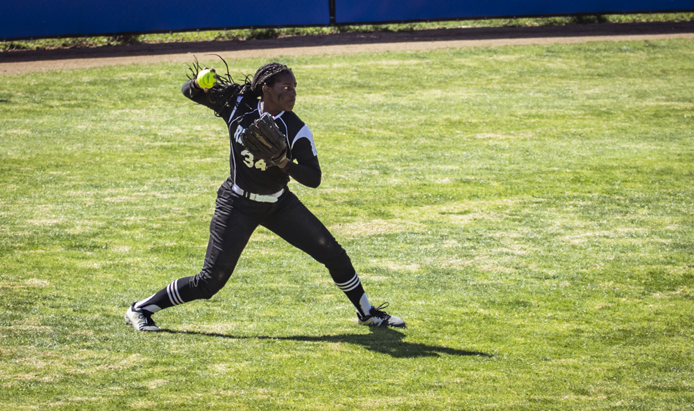 Ohlone outfielder Kaelani Ratliff fields a ball during Moorpark's home game against the renegades on Saturday, Feb. 29. Ratliff hit four balls out of her five at-bats, and scored two runs for the Renegades.