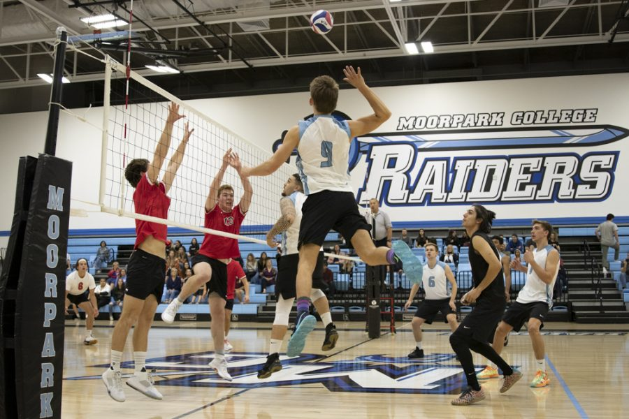 Freshman Jake Cecena leaps up from the outside to meet a set from Lucas Ogg during Moorpark's home game against Santa Barbara City College on Wednesday, Feb. 26. Cecena finished with seven kills and three digs. Photo credit: Evan Reinhardt