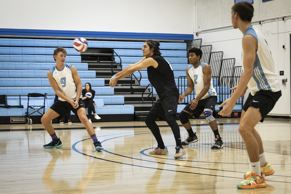 Sophomore Chris Corcino extends his arms to pass a serve during Moorpark's home game against Santa Barbara City College on Wednesday, Feb. 26.