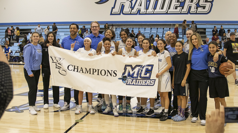The Moorpark women's basketball team poses for a photo opportunity after winning the conference final against Ventura, on Saturday, Feb. 15. The Raiders defeated the Pirates 69-54