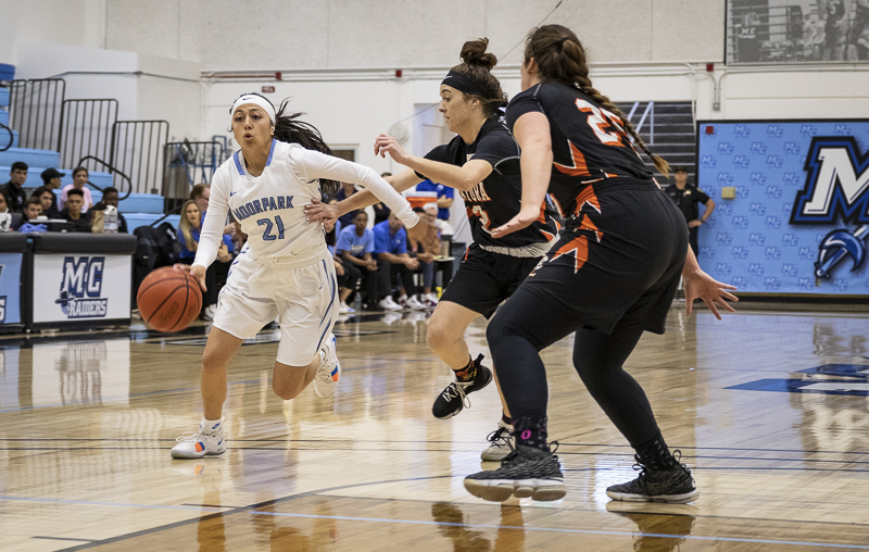 Jazzy Carrasco dribbles past Ventura College defenders during Moorpark's home game on Saturday, Feb. 15.