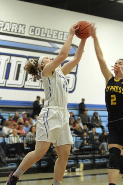 Caleigh McClenahan jumps up for a layup during Moorpark's home game against Cypress College on Saturday, March, 7. Photo credit: Bruce Arikawa
