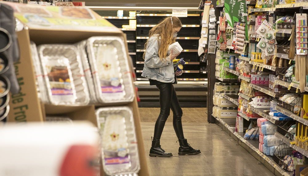 Summer Bartholomew searches for a few items at the Ralph's in Moorpark on Thursday, March 26. Bartholomew works on a ranch in Moorpark, and says that if people didn't stockpile, there would always be enough to go around.