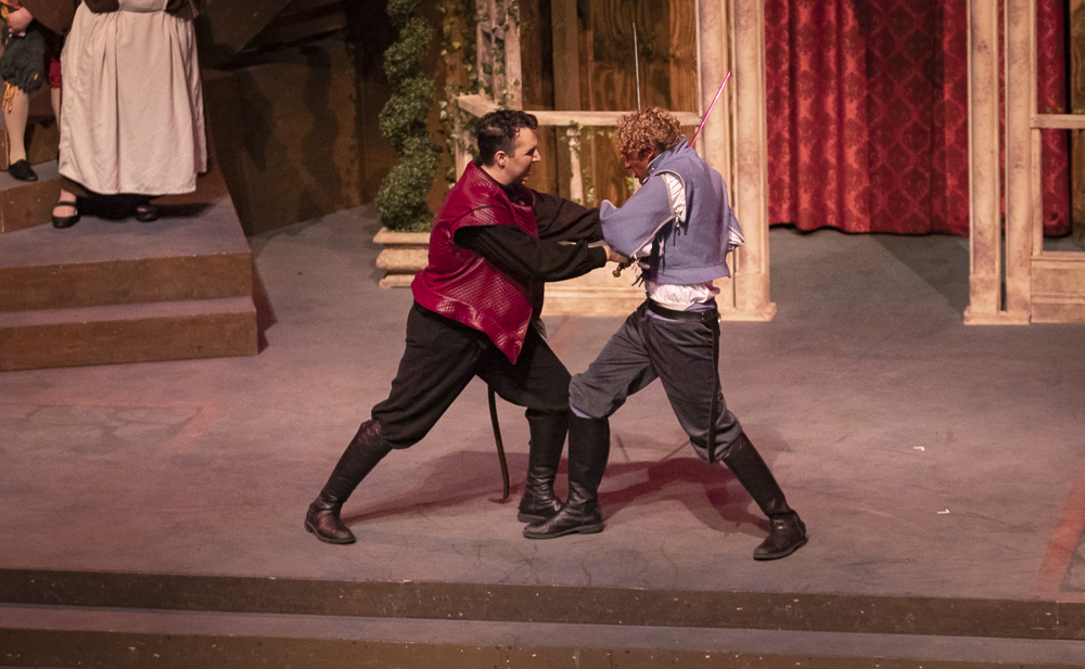 Jaz Johnson, left, as Tybalt, engages in a duel with Seth Gunawardena, as Romeo, during the Romeo and Juliet performance on Thursday, March 12, in the performing arts building.