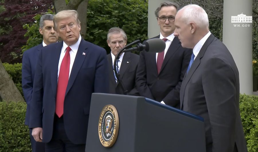 President+Donald+Trump+watches+as+Warner+Thomas%2C+CEO+and+president+of+Ochsner+Health+System%2C+during+the+press+briefing+on+Tuesday+April+14%2C+in++the+White+House+Rose+Garden.+Image+taken+from+whitehouse.gov+via+live+stream.