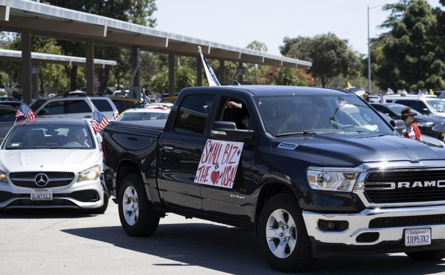 Protesters display signs on vehicles as they urge the Ventura County to re-open.