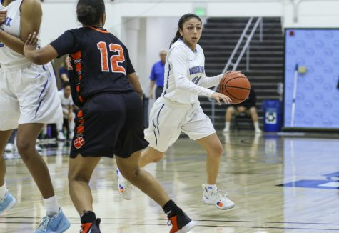 Sophomore guard Jazzy Carrasco comes off a screen during their home game against Riverside City College on Saturday, Feb. 29. Carrasco reached a milestone of 1000 career points during the game. Photo credit: Danny Stipanovich