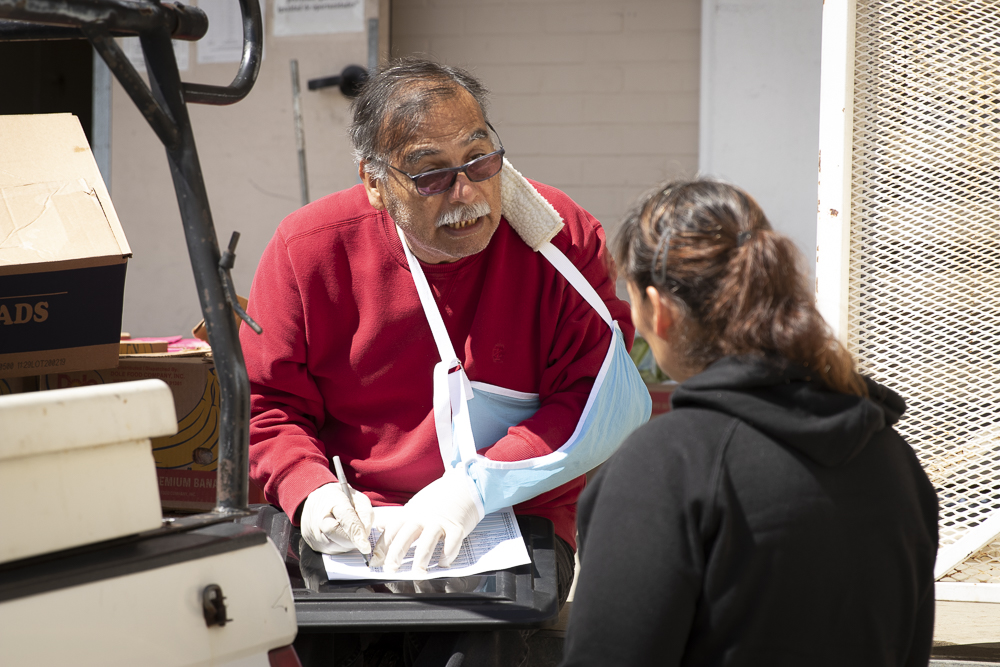 Dan Cruz manages the Moorpark College Food Pantry for locals desperate for some food, on Tuesday, March 17, in Moorpark, Calif.