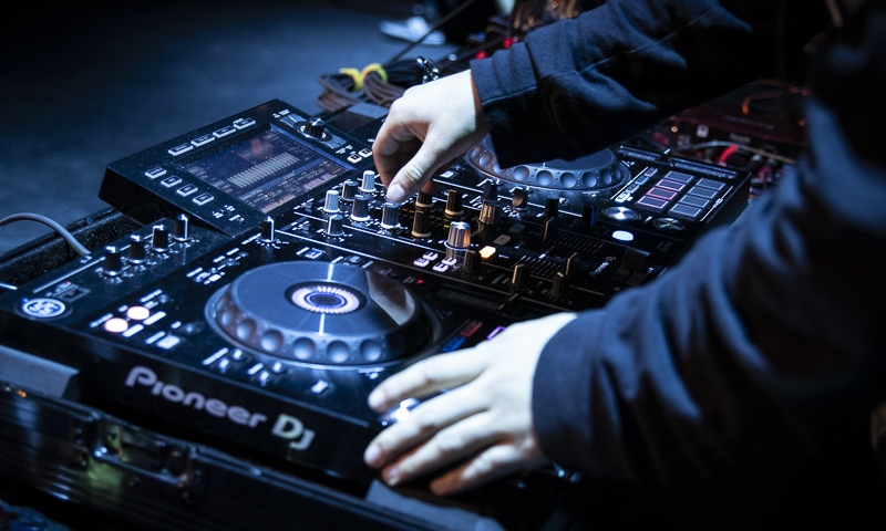 Andy Soto, also known as Dreamix, manipulates the mixing equipment during his set of the previous Student DJ Showcase, held in the Black Box Theater on Friday, Jan. 31, 2020. Performers used a mixture of school and personal equipment during the show. Photo credit: Evan Reinhardt
