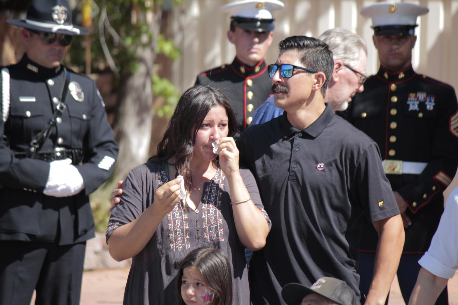 Andrea Pongo, her husband Andreas Pongo and their daughter Noelle Pongo, 5, are overwhelmed with emotion on April 26, 2020, during a parade honoring Andreas's brother Diego Pongo, a Marine who was killed in Iraq in March.