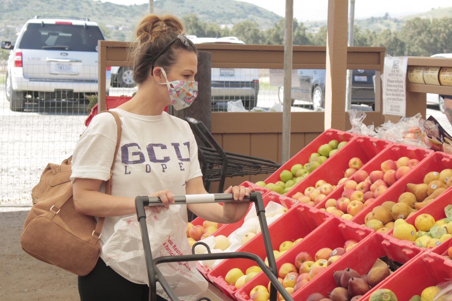 Megan Harper from Moorpark shops for produce at Underwood Farms in Moorpark on April 28, 2020.