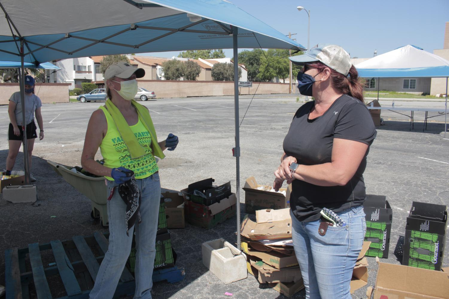 Volunteer Suzanne Morrow and Simi at the Garden president Jodie Francouer help pass out free produce to the community on May 5, 2020 in Simi Valley.