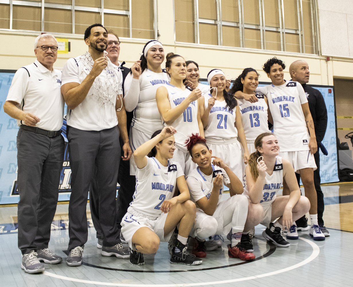 The Moorpark College women's basketball team pose for a photo after their CCCAA Southern California regional final win over Glendale College on Saturday, March 9 in the Moorpark College gym. Each player holds a piece of the court's net after playing their final game in the gym.