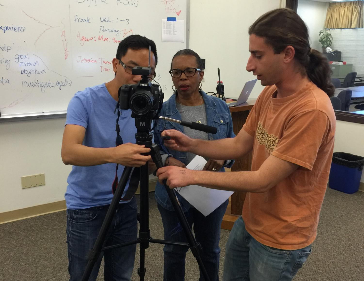 Nikolas Samuels (left) helps other students set up camera equipment. Photo provided by Joanna Miller.