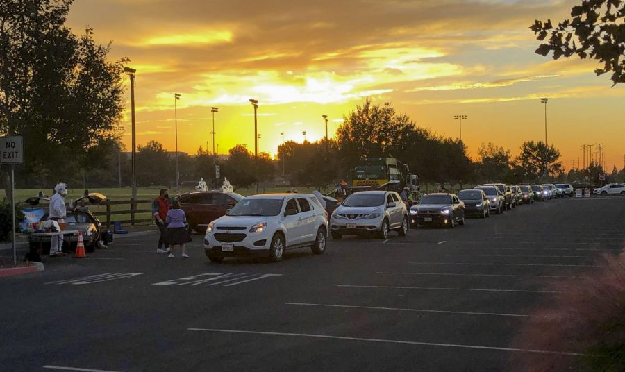 Cars line up for the Spooky Avenue Halloween Drive Thru in Moorpark, CA. on Saturday, Oct. 31. Photo credit: Adriana Janiga