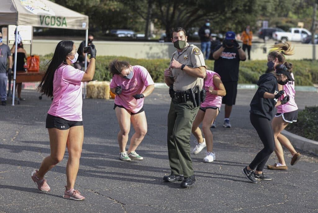 The girls softball team volunteer and teach the Thousand Oaks Police Department Chief of Police, James Fryhoff, a tiktok dance.