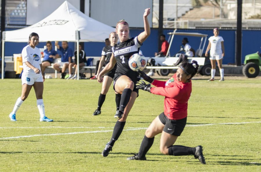 Carolyn Quandt, 7, juggles the ball over Oxnard College's goalie during Moorpark's game against Oxnard College on Tuesday, Oct. 15 Quandt proceeded to maneuver around the goalie and finish with an easy goal. Photo credit: Evan Reinhardt