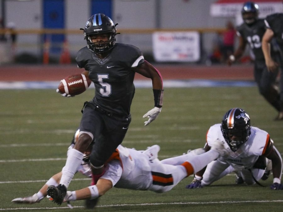 Wide Receiver Dylaan Lee breaks through multiple tackles as he completes a 47 yard reception during the home game against Ventura College on Oct. 27. Photo credit: Ryan Bough