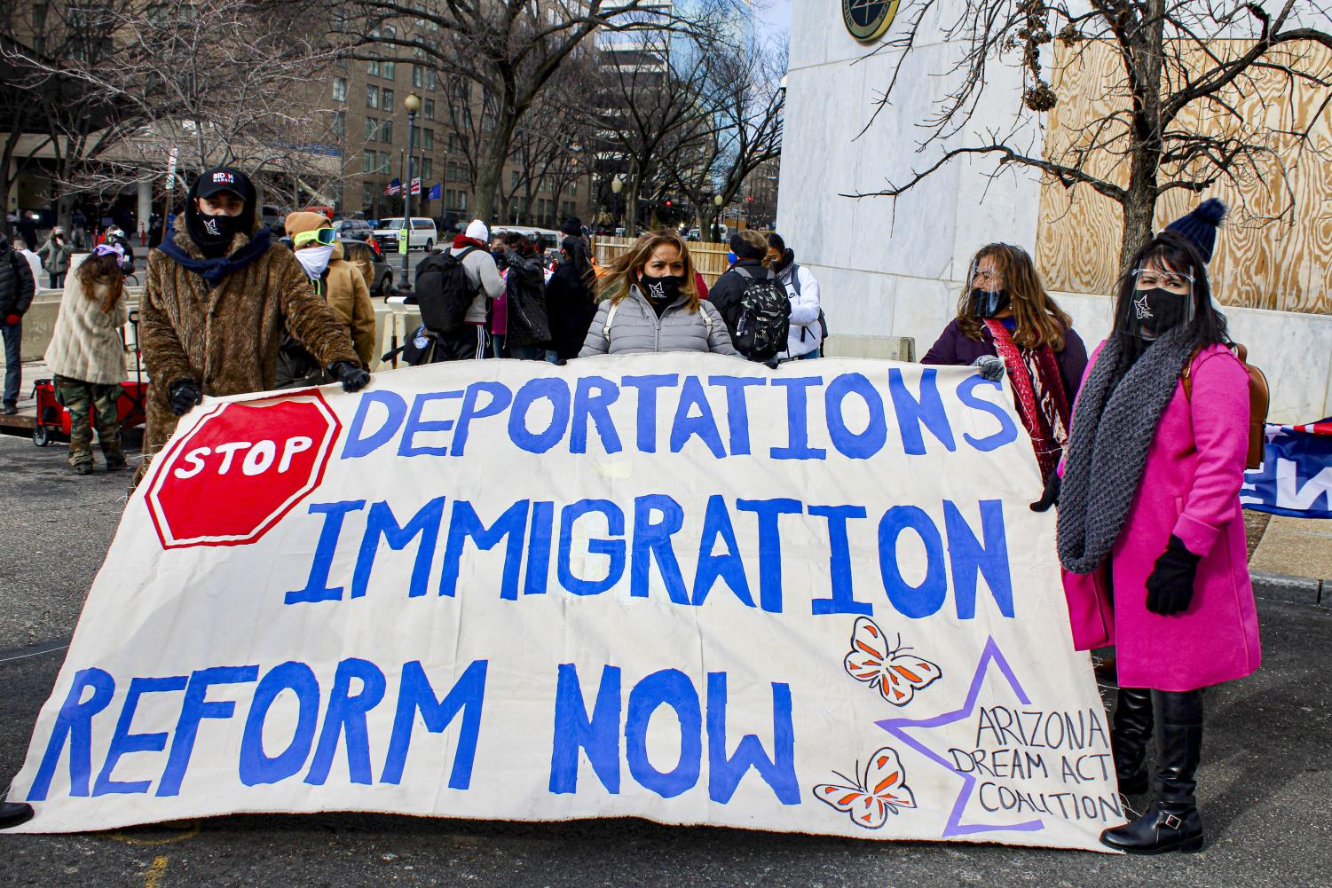 Protestors stand out of the Capitol calling for reform to Immigration at Joe Biden's inauguration on Jan. 20, in Washington D.C.