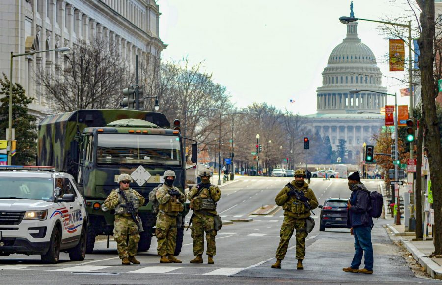 National Guard soldiers guard the streets towards the Capitol building during Joe Biden's inauguration on Jan. 20, in Washington D.C. There were over 25,000 national guard members sent to the Capitol for security. Photo credit: Andrea Lopez
