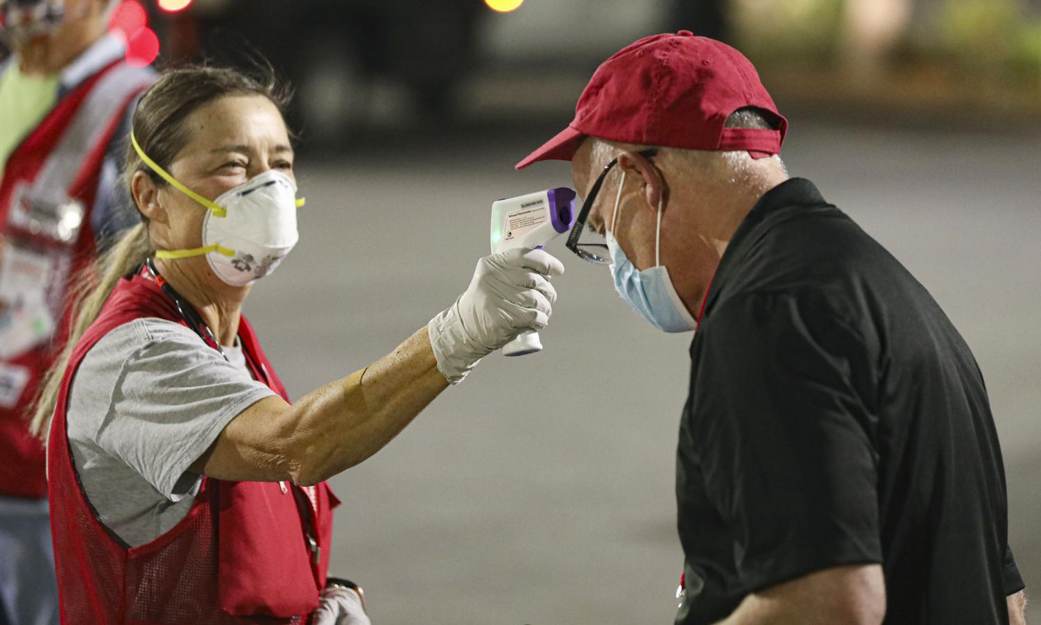 Liz Lepey, a registered nurse with the American Red Cross takes Dave Wagner's temperature at the Red cross evacuation center during the Erbes Fire in Thousand Oaks, CA, on Thursday, Jan. 14.