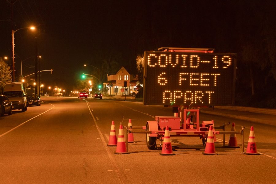 A sign on Princeton Ave. in Moorpark alerts people to social distancing measures during the coronavirus pandemic on May 13, 2020. Photo Credit: Justin Downes