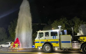 Ventura County Fire Department Station 41 attempting to shut off the water after a car runs over a fire hydrant in Simi Valley, CA. on Jan. 29, 2021. Photo credit: Amber Urban