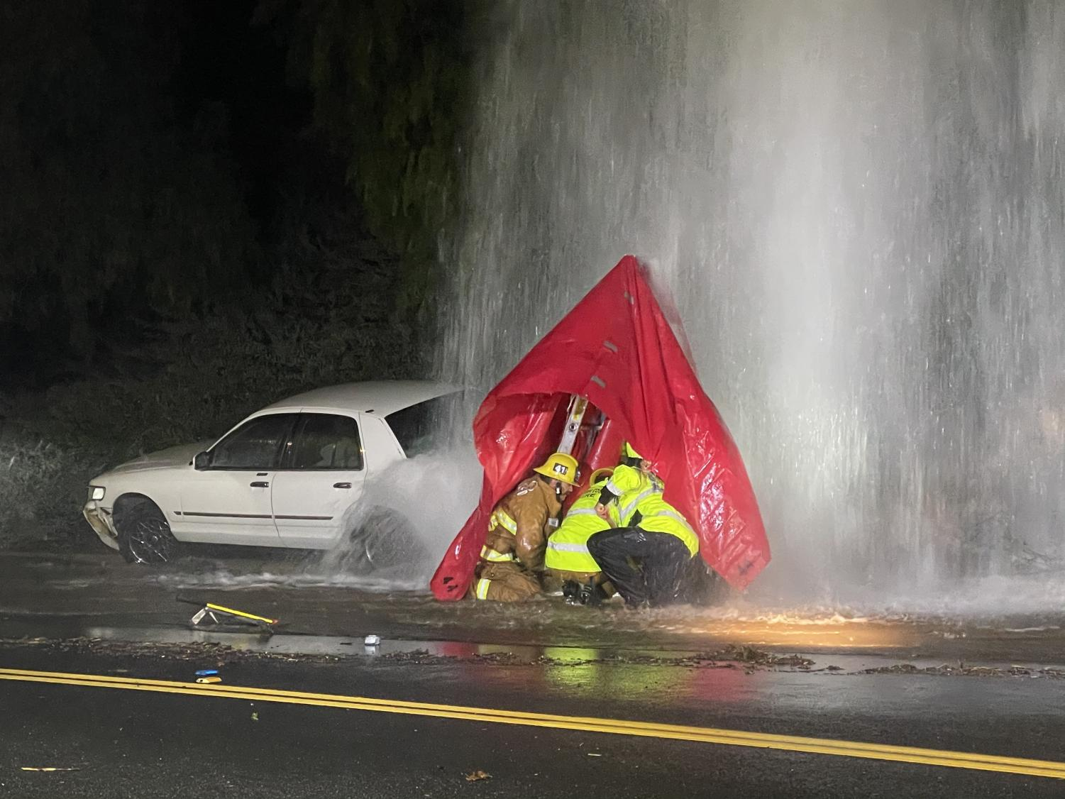 Ventura County Fire Department uses a ladder to make an 'A' frame over the shut-off valve to shelter them from the water.