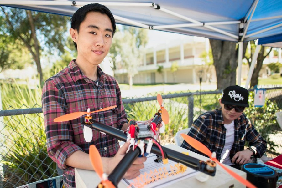 Calvin Tan, 20, holds a drone while promoting the Engineering Club Feb 14, 2017 Moorpark College Photo credit: James Schaap