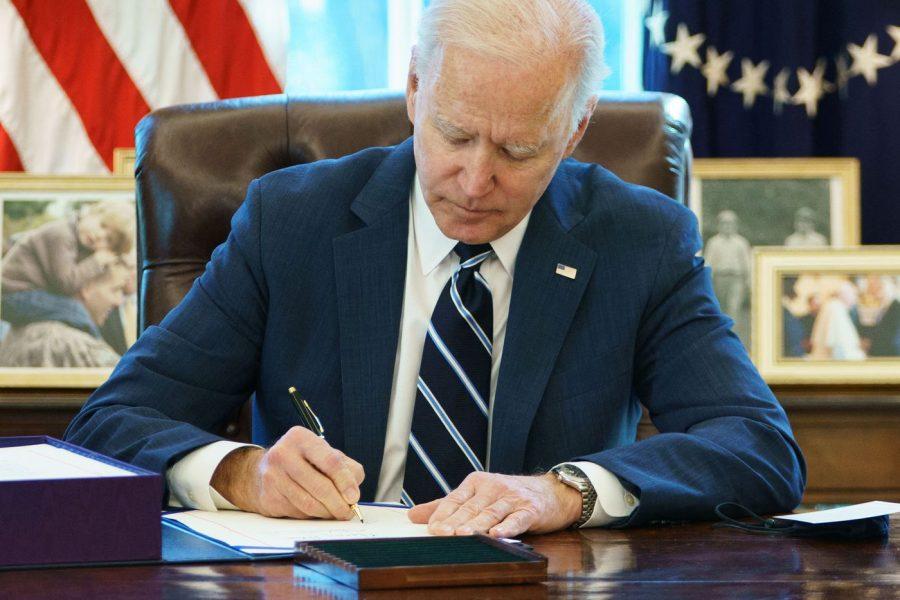 U.S. President Joe Biden signs the American Rescue Plan. Photo by MANDEL NGAN / MCT